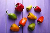 Pepper on wooden background