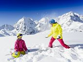 Ski, skier, sun and winter fun - skiers enjoying winter vacations