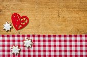 Wooden background with cookies and a felt heart