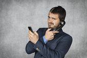 Unhappy Businessman Talking On The Phone
