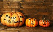 Halloween pumpkins on wooden table background