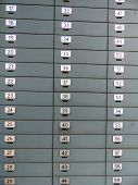 lockers with numbers in a bank for safekeeping of valuables.