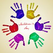 handprints of different colors forming a circle and the text childrens day written in the center on a beige background