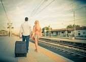 Couple Walking At Train Station