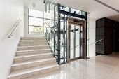 picture of elevators  - Hall with staircase and elevator inside the building