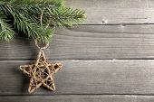 Christmas decoration with fir branch and wooden star
