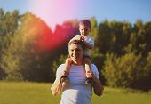 Happy Father With Son Having Fun Outdoors, Sunny Summer Day, Warm Sunset