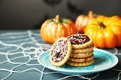 image of spiderwebs  - Tasty Halloween cookies on plate - JPG