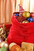 Red bag with Christmas toys on fabric background