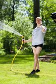 Man Without Trousers Watering The Plants
