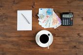 Cup Of Coffee, Calculator,  Notepad And Euro Money