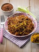 red rice with curry and leek