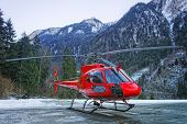 Red Helicopter On The Base In Swiss Alps