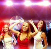 new year celebration, friends, bachelorette party, birthday concept - three beautiful woman in evening dresses dancing in the club