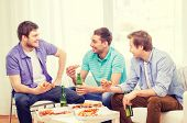 friendship, food and leisure concept - smiling male friends with beer and pizza hanging out at home
