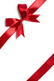 image of ribbon decoration  - Shiny red satin ribbon on white background - JPG