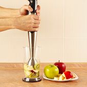 stock photo of blender  - Hands chefs are going to mix fruit cocktail in a blender - JPG