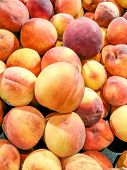 foto of peach  - Many fresh ripe peaches in a fruit market - JPG
