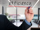 stock photo of efficiencies  - Businessman writing concept of efficiency business process - JPG