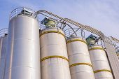 pic of silos  - Detail of chemical plant silos and pipes - JPG