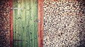 picture of wooden shack  - Retro photo of old rustic wooden door with firewood - JPG