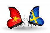 image of sweden flag  - Two butterflies with flags on wings as symbol of relations Vietnam and Sweden - JPG