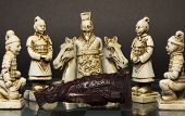 pic of humility  - Dead black king lying in front of white king and his soldiers.