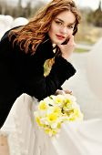 picture of windy  - pretty girl with daffodils in windy spring day - JPG