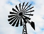 stock photo of water-mill  - Old water pumping windmill - JPG