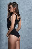 picture of leotards  - beautiful woman in black leotard posing on grey background - JPG