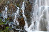 stock photo of dam  - Water flowing among rocks creating beautiful waterfalls at Xyliatos dam area in Cyprus  - JPG