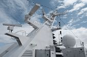 stock photo of passenger ship  - Satellite communication antenna on the top of large passenger ship. Close details of radar navigation system and communication tower.