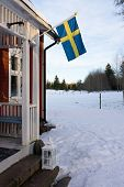 picture of sweden flag  - Entrance to an old wooden house in Sweden - JPG