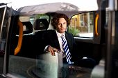 picture of cabs  - Image of handsome male passenger sitting in cab - JPG
