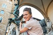 picture of perseus  - Young woman taking photo of statue perseus with the head of medusa in florence italy - JPG