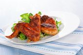 picture of chicken wings  - Delicious buffalo wings on plate with fresh green salad - JPG