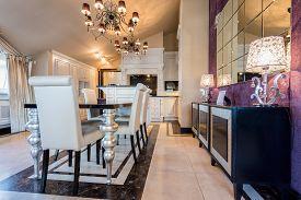 picture of mansion  - Illuminated dining room interior in luxury mansion - JPG