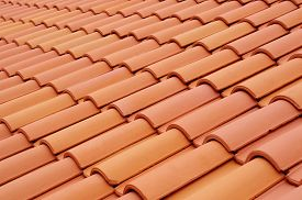 stock photo of red roof  - New roof with ceramic tiles close up - JPG