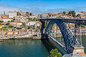 stock photo of dom  - Dom Luis I bridge in Porto in Portugal in a summer day - JPG