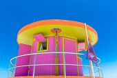 pic of beach-house  - Pink lifeguard house in typical architecture during summer day in Miami Beach - JPG