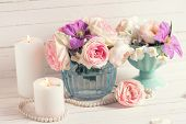 pic of white roses  - Pink roses white jasmine and violet clematis flowers and candles on white wooden background - JPG