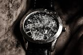 stock photo of gallows  - Damaged watch in male dirty hand close up - JPG