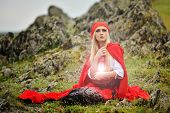 stock photo of cloak  - beautiful woman with red cloak in the sunset light - JPG