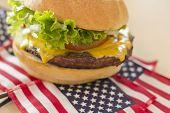 stock photo of patriot  - Patriotic American flag cheeseburger for American patriotism celebration food image - JPG