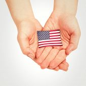 picture of presenting  - Hands presenting against usa national flag - JPG