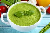 image of vegetable soup  - Tasty peas soup and vegetables on table close up - JPG