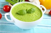 picture of vegetable soup  - Tasty peas soup and vegetables on table close up - JPG