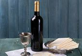 foto of matzah  - Matzo for Passover with metal tray and wine on wooden background - JPG