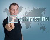 picture of suggestive  - Young man press digital Suggestion button on interface in front of him - JPG