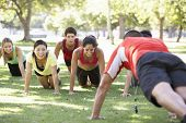 stock photo of woman boots  - Instructor Running Fitness Boot Camp - JPG